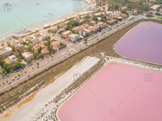 Aerial view of residential area by colourful saline lakes, Cagliari, Sardinia