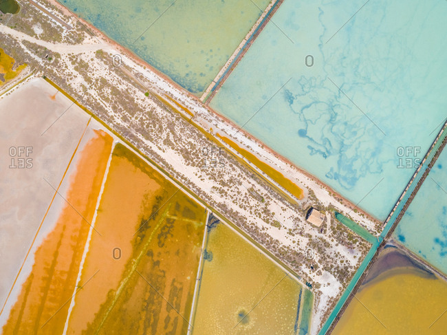 Aerial view of colourful saline lakes and outbuilding, Cagliari, Sardinia