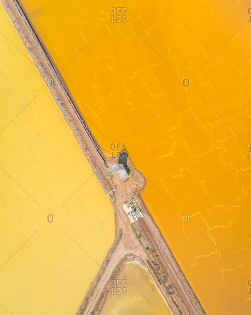 Aerial view of abstract two colored Saline Conti Vecchi, Cagliari, Sardinia
