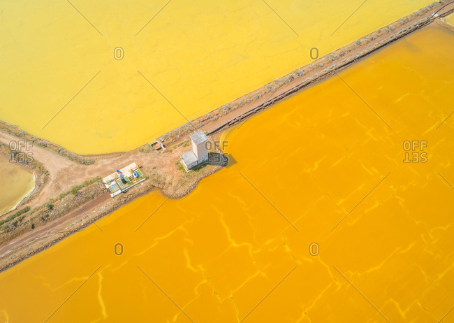 Cagliari, Sardinia - August 24, 2018: Aerial view of abstract colourful Saline Conti Vecchi, Cagliari, Sardinia