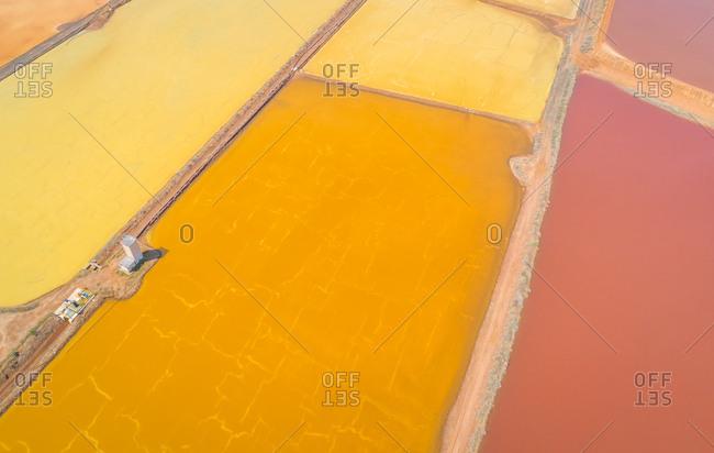 Aerial view of abstract colourful Saline Conti Vecchi, Cagliari, Sardinia