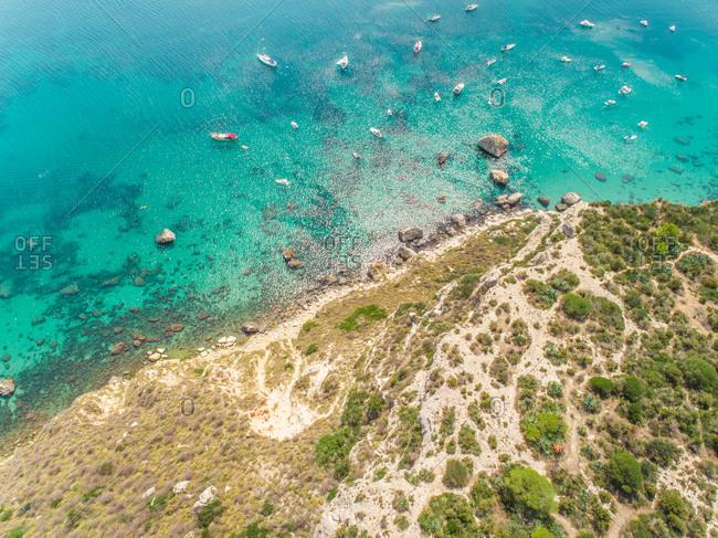 Aerial view of Sella del Diavolo rocky coast and boats, Cagliari, Sardinia
