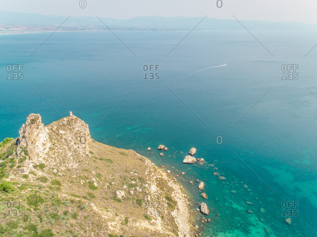 Aerial panoramic view of hazy coastline, sea and rocks, Cagliari, Sardinia