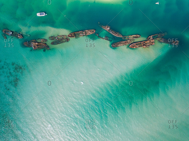 Aerial view of yachts and Tangalooma shipwrecks in Moreton Bay, Australia
