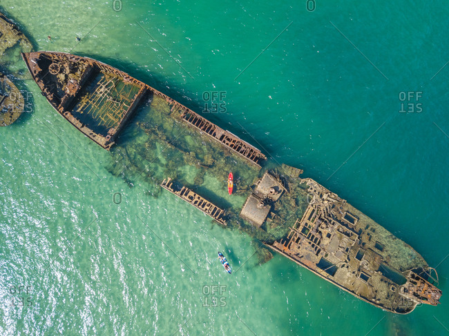 Aerial view of kayak and Tangalooma shipwrecks in Moreton Bay, Australia