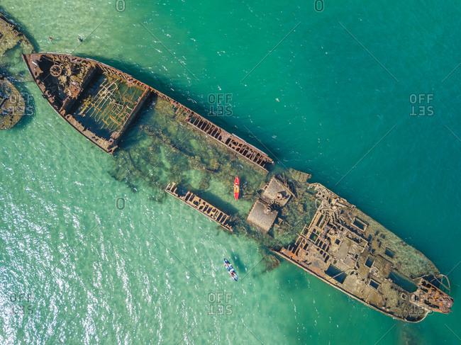 Aerial view of kayak and Tangalooma shipwrecks in Moreton Bay, Australia