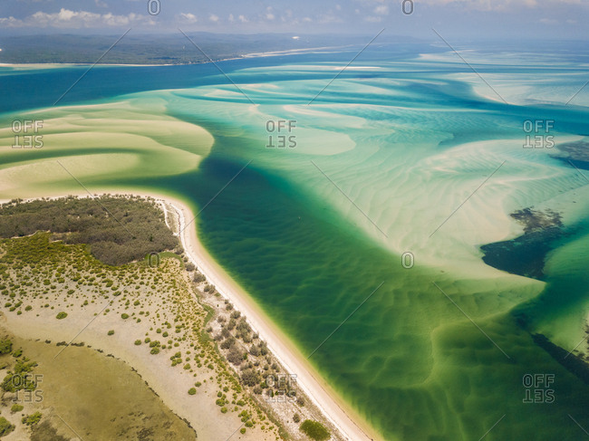 Aerial abstract view of shoals and coast off Kooringal, Moreton Island, Australia