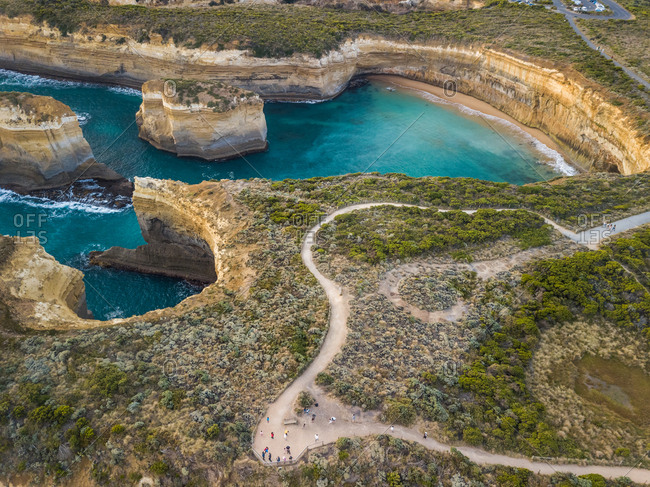 Aerial view of tourists and road in Loch Ard Gorge, Port Campbell, Australia