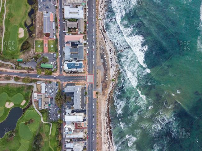 Aerial view of coastal road and residential buildings and football grounds, Mouille Point, Cape Town