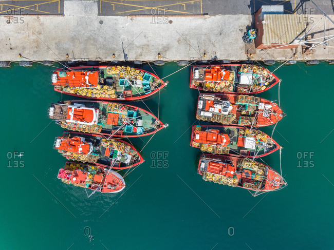 Aerial view of eight fishing boats in Hout Bay, Cape Town
