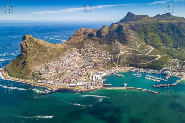 Aerial panoramic view of Hout Bay Harbor, yachts and hillside town, Cape Town
