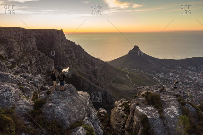 CAPE TOWN, SOUTH AFRICA - APRIL 2018: Aerial view of tourists on Table Mountain at sunset, South Africa