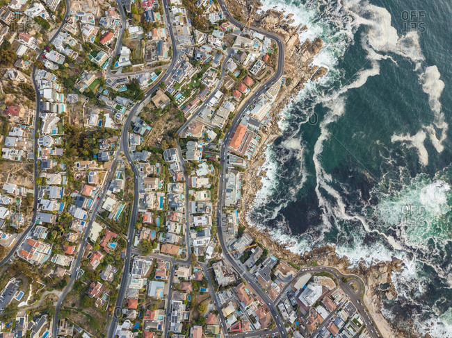Aerial abstract view of coastal winding road and city, Bantry Bay, South Africa