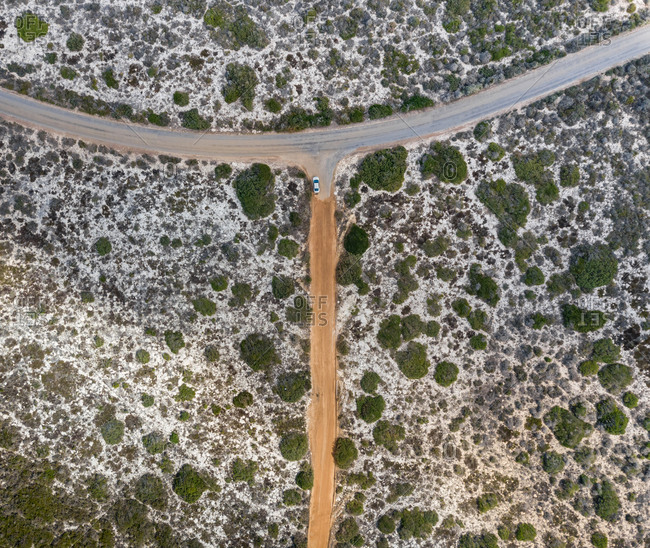Aerial abstract view of one car in empty road in West Coast, South Africa