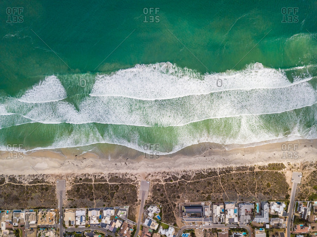 Aerial view of Sunset Beach and rich residential area, Cape Town, South Africa
