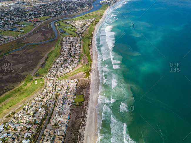 Aerial view of Sunset Beach and residential area, Cape Town, South Africa