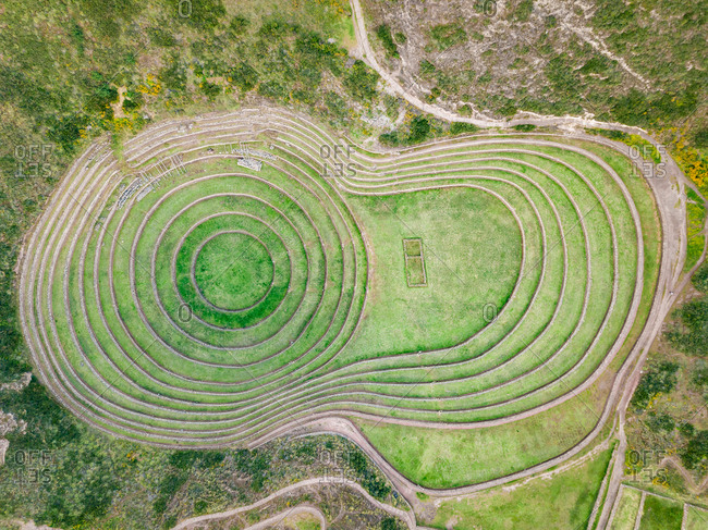 Aerial view of terraced circular depressions of Moray archeological site, Peru
