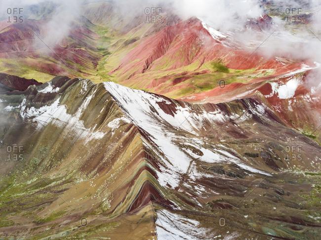 Aerial view of snowy peaks of  Vinicunca, Rainbow Mountain, Peru