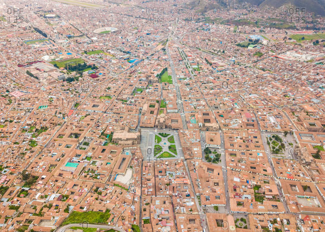 Aerial abstract panoramic view of Cuzco city red rooftops, Peru