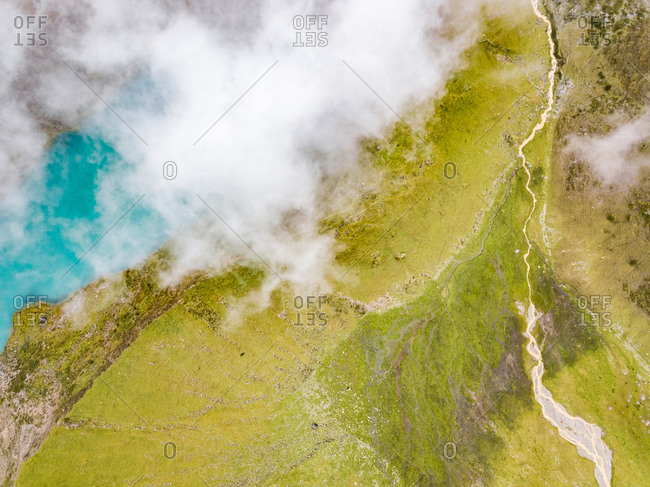 Aerial view of cloudy  Humantay Lake and green valleys, Peru