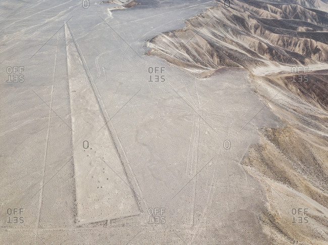 Aerial view of triangle  geoglyph in Nazca, Peru