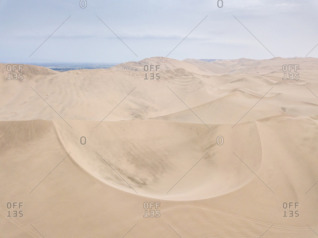 Aerial abstract view of sand dunes in Ica desert, Peru