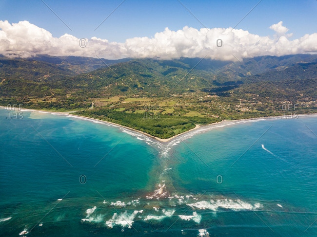 Aerial panoramic view of Punta Uvita with  hills in clouds, Costa Rica