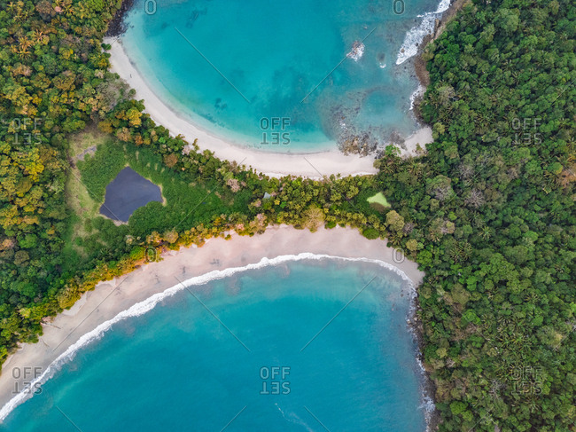 Aerial view of lagoons and palm trees in Espadilla Beach, Costa Rica