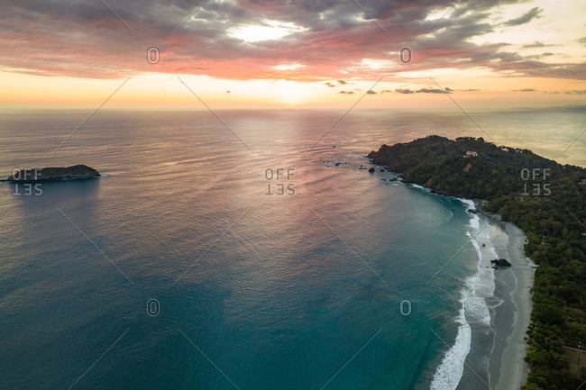 Aerial view of sunset over Espadilla Beach peninsula, Costa Rica