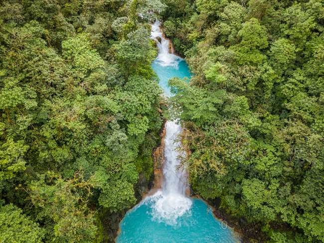 Aerial view of natural turquoise pools of Celeste Waterfall, Costa Rica