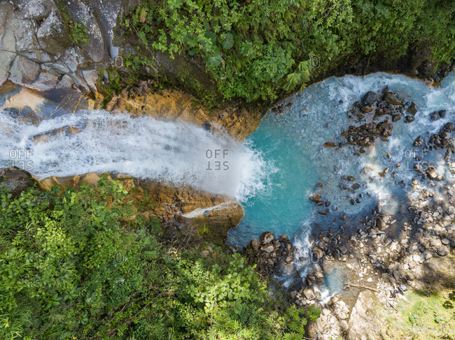 Aerial closeup view of natural turquoise pool of Celeste Waterfall, Costa Rica