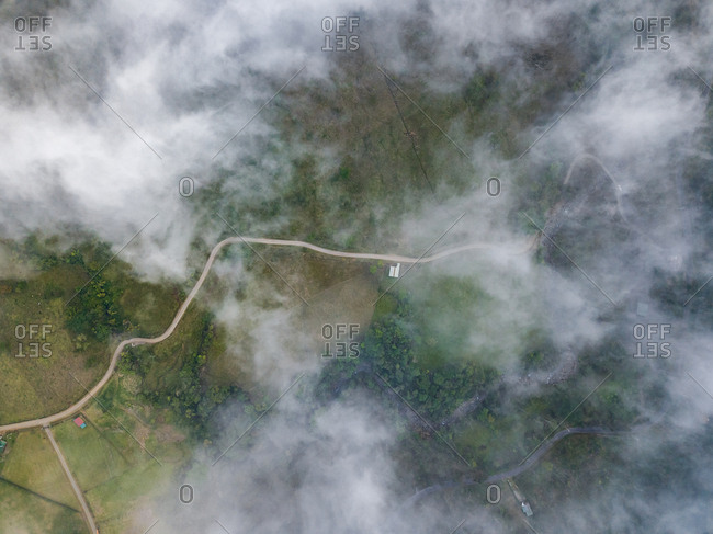 Aerial misty view of long road in Bajos del Toro area, Costa Rica