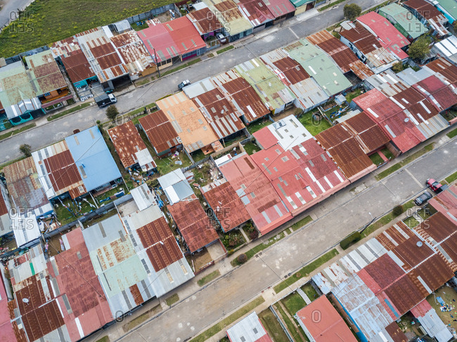 Aerial view of residential buildings and rooftops  of Cot city in Costa Rica