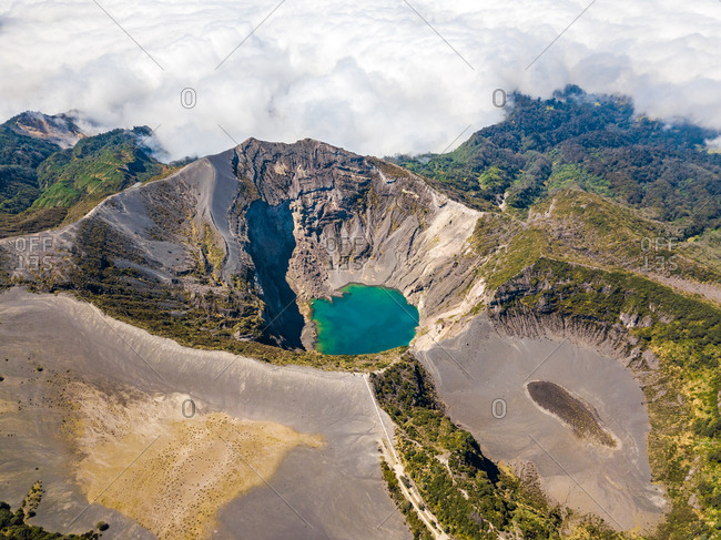Aerial panoramic view of active Irazu volcano in clouds, Cartago, Costa Rica