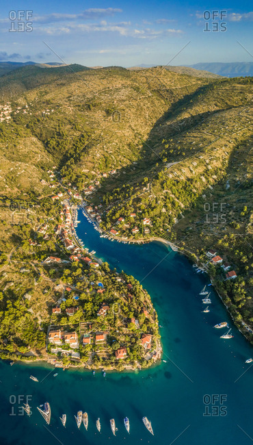 Aerial panoramic view of Sutivan town, boats and hills , Brac island, Croatia