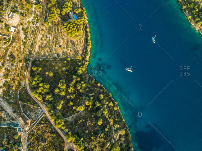 Aerial view of two yachts in Adriatic sea by Sutivan town, Brac island, Croatia