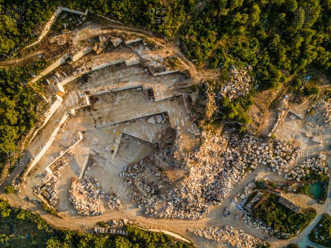 Aerial view of quarry, white famous Brac stone and trees, Brac island Croatia