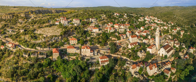 Aerial panoramic view of traditional dalmatian village of Lozisca, Brac Island, Croatia