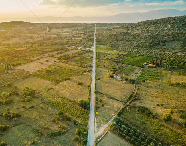 Aerial panoramic view of long road in Nerezisca dalmatian village, hills and seaside, Brac Island, Croatia