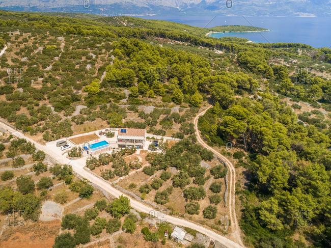 Aerial panoramic view of Brac island, villa and pool in Sumartin, Croatia