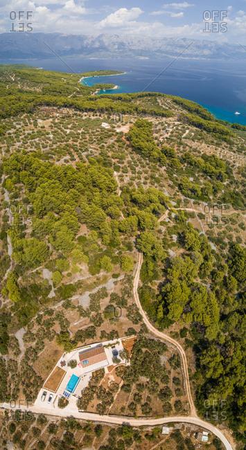 Aerial panoramic view of Brac island, villa and mountains, Sumartin, Croatia