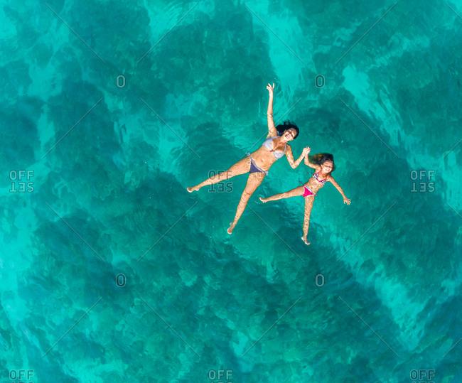 Aerial view of woman and young girl swimming in sea, Brac island, Croatia