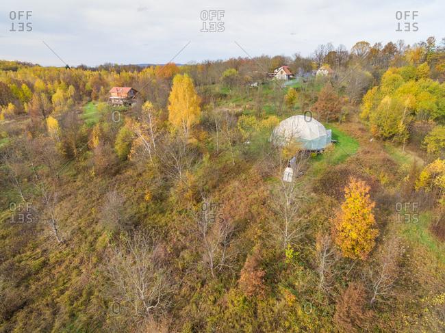 BLATUSA, CROATIA - 11 NOVEMBER 2017: Aerial view of Blatusa eco village, Eko selo, in autumnal forest, Croatia