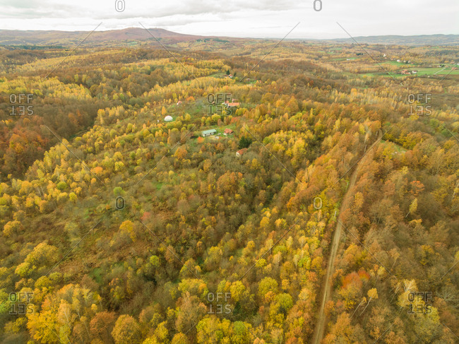 Aerial panoramic view of rural village in autumnal forest, Blatusa, Croatia