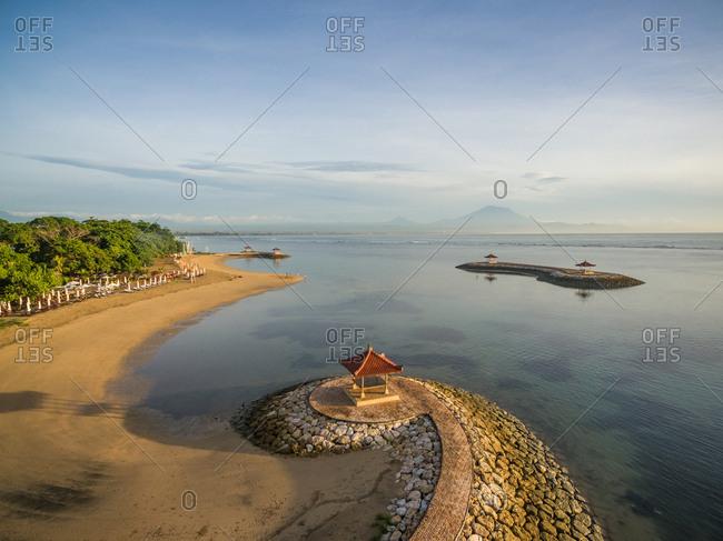 Aerial abstract view of man made coastal stone formation with pagoda and seascape,Pantai Karang, Bali