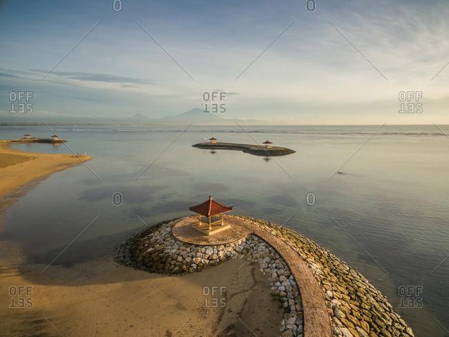 Aerial view of man made coastal stone formation with pagoda and seascape,Pantai Karang, Bali