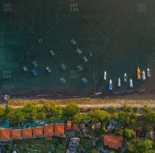 Aerial view of pump boats and yachts by coast with residential buildings, Puntai Karang, Bali