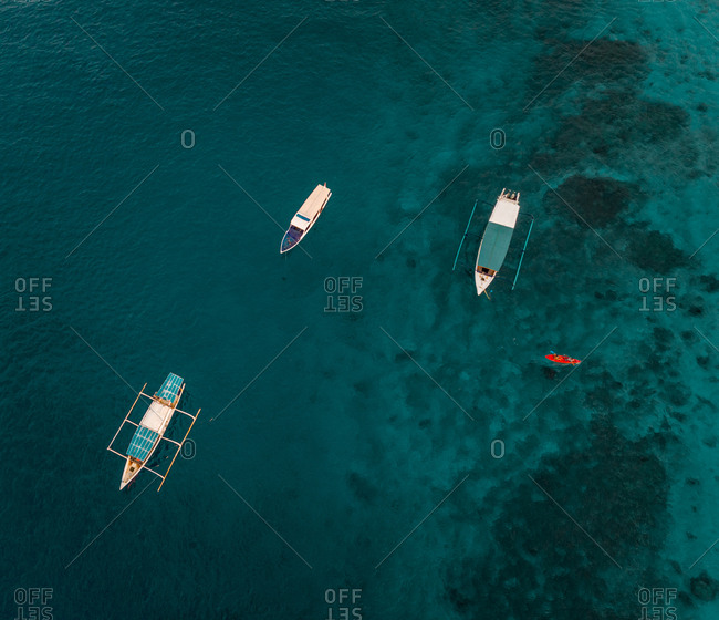 Aerial view of boats in turquoise waters off Gili Islands, Indonesia
