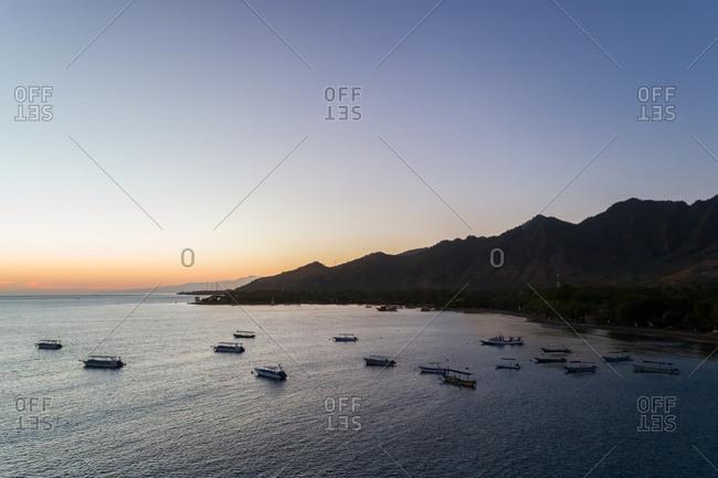 Aerial view of fishing boats departing at sunrise, Gerokgak, Bali