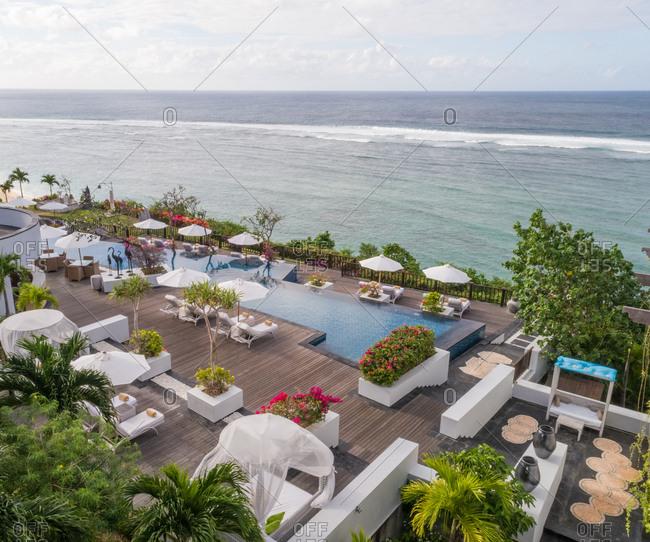 KUTA SELATAN, BALI - 6 JULY  2018: Aerial view of Samabe Bali Suites and Villas resort wooden terrace, Bali